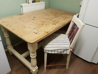 Solid Farmhouse table with 4 chairs.