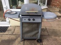 Gas barbecue with side burner and shelf for food and plates etc, large grill area with lid and coals