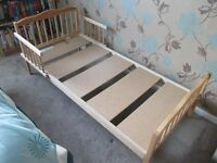 CHILD'S WOODEN BED FRAME 57 INCHES X 27 INCHES. EXCELLENT CONDITION.
