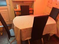 Extendable Glass dining table and 4 black chairs