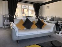 White and grey leather sofa