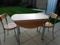 Foldable table with two chairs