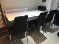 White high gloss table and 4 black leather chairs
