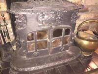 Antique looking, detailed , multi-fuel , Cast iron stove requiring some TLC.