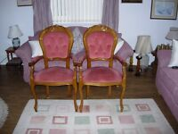 Two upright arm chairs for sale.