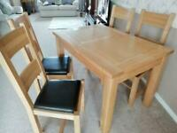 Solid oak extending table & chairs as new