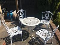 Cast Aluminium garden table and chairs.