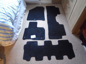 a BRAND NEW SET of 4 CUSTOM FITTED BLACK MATS for a KIA SORENTO 7 SEATER 2015-2021 MODELS