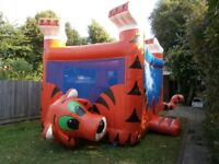 Commercial bouncy castle (tiger themed) £ 370 ono