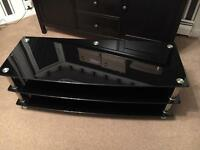 Large black glass and chrome tv stand unit