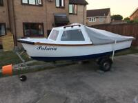 Fishing boat ready to go with engine and trailer