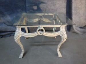 Metal framed, glass topped, decorative table