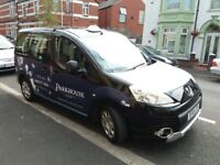 New model Peugeot partner tepee with taxi plate