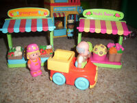 Happyland fruit and veg and flower stall plus produce, people and car