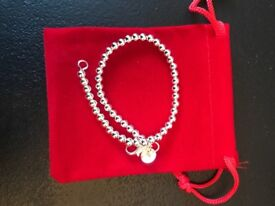 Dainty silver bracelet with red velvet pouch
