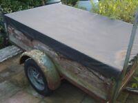 Wooden trailer with metal frame ladder rack