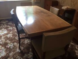 Lovely dark wood dining table with 4 chairs