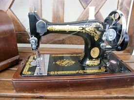 Singer sewing m/c. hand cranked perfect condition in carry case as new.