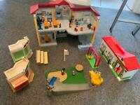 Two Playmobil schools and other bits and figures.