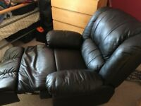 Fully-reclining black leather-look armchair