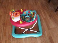 Sparingly used baby walker (make: Bright Starts)