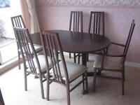 Extending Dinning table and 6 chairs.