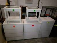 White chests of drawers and other items
