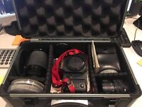 canon t70 with speedlite flash, Canon Zoom Lens and vivitar zoom lens. Along with case.