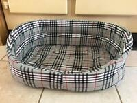 Drop-fronted, tartan padded pet bed.