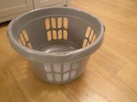 Grey plastic laundry basket (FREE)