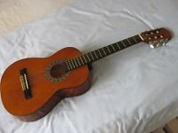 Three quarter size guitar with carrying case.