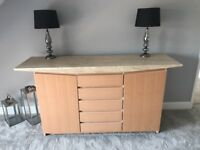 Light brown sideboard with stone top