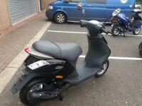 Brand new black Piaggio ZIP Scooter