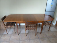 Genuine Vintage G-Plan solid walnut dinning room table which is extendable with a separate leaf