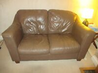 Two identical 2-seater brown leather sofas free to good home.