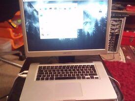 2009 Macbook Pro - + Monitor - 160 GB HD - 4GB Ram - WORKS WELL