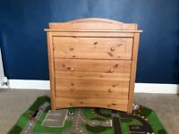 Chest of drawers with baby changing on top
