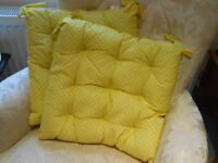Set of four seat cushions for dining/kitchen chairs, brand new, very attractive. Yellow/white spots