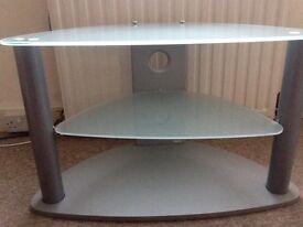 Glass corner Tv unit