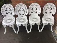 4 matching white bistro chairs
