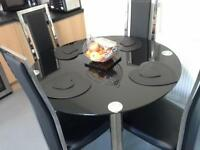dining table@ four chairs excellent condition black glass round table four black and chrome chairs