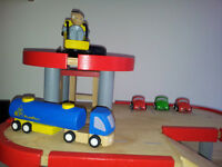 Wooden toy garage with cars, lorry and people