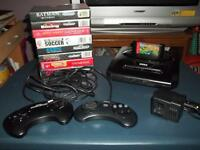 Sega Genesis Console (model #2) with accessories and 8 games