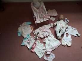 Baby Annabell doll, baby bouncer and clothing bundle