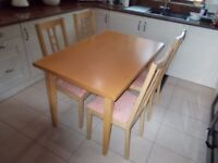 A LOVELY MODERN STYLE DINING / KITCHEN TABLE AND FOUR RE-UPHOLSTERED CHAIRS