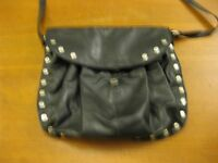 Large black plastic bag with metal studs