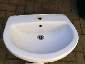 Sink basin and shroud pipework cover