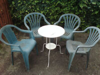 8 plastic garden chairs and steel table