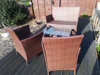 Rattan sofa two chairs and coffee table