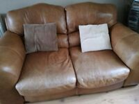 3 and 2 seater sofa with foot stool. Tan distressed look leather.